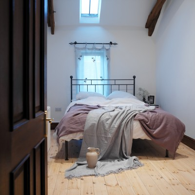 Knights In Iron unmade bed interior photography UK