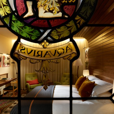 The Hospital Club hotel room with stained glass window